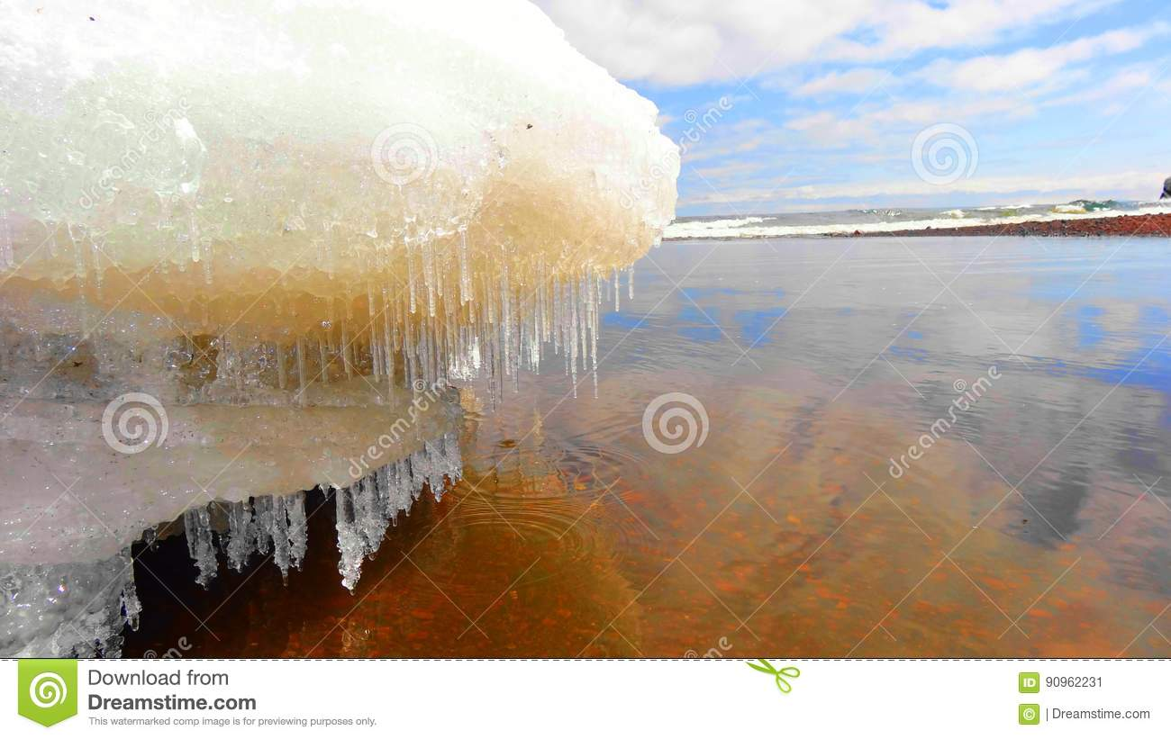 Icicles on the melting snow on Lake Superior in the Spring