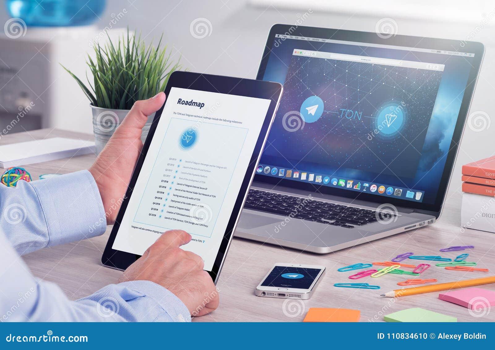 ICO Investor reads Telegram Open Network TON white paper roadmap on the iPad screen