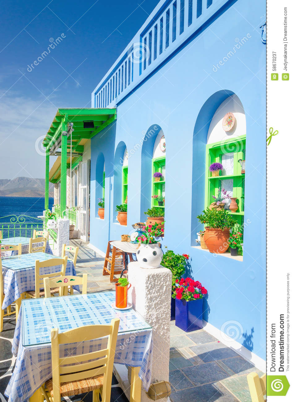 Iconic greek restaurant with blue tablecloth greece stock