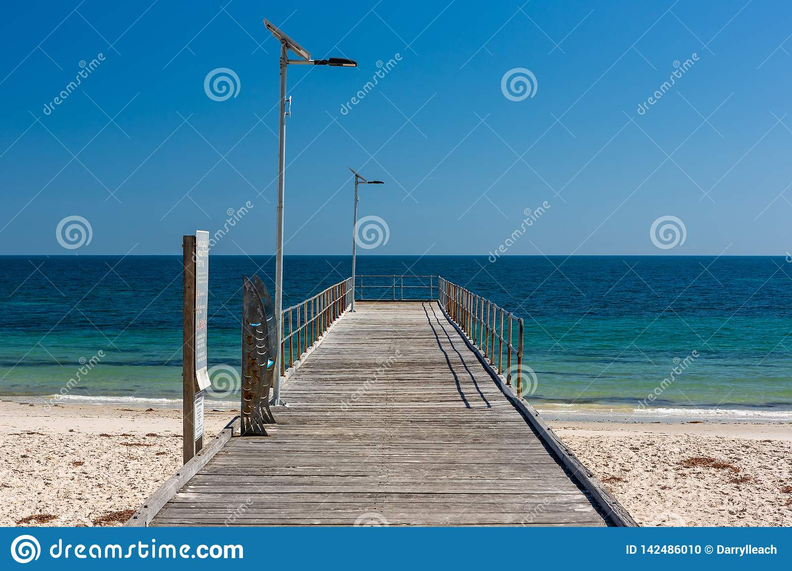 The iconic Normanville jetty with no people and blue skies on a bright sunny day on the Fleurieu Peninsula South Australia  on