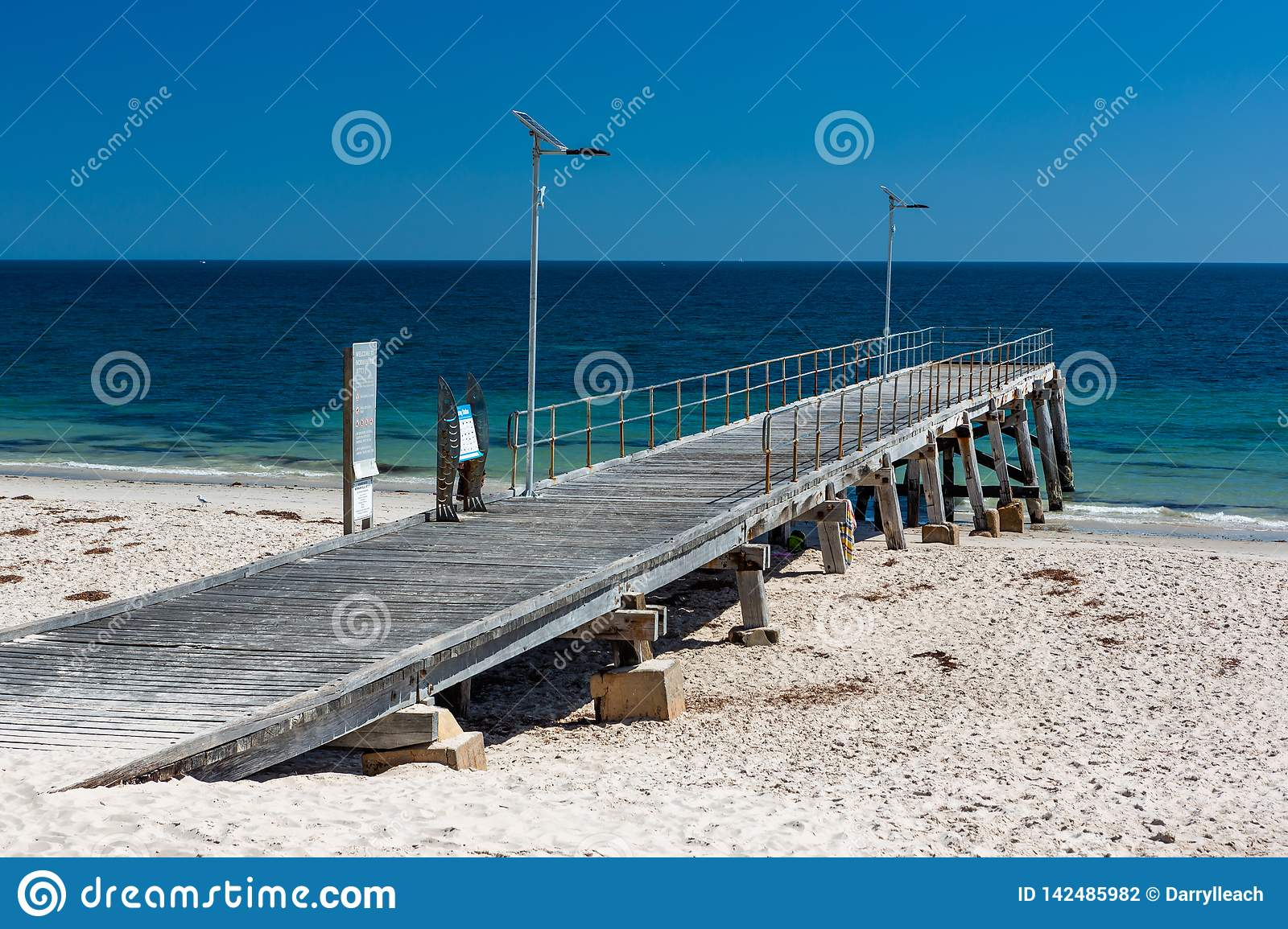 The iconic Normanville jetty with no people and blue skies on a bright sunny day on the Fleurieu Peninsula South Australia on 20th