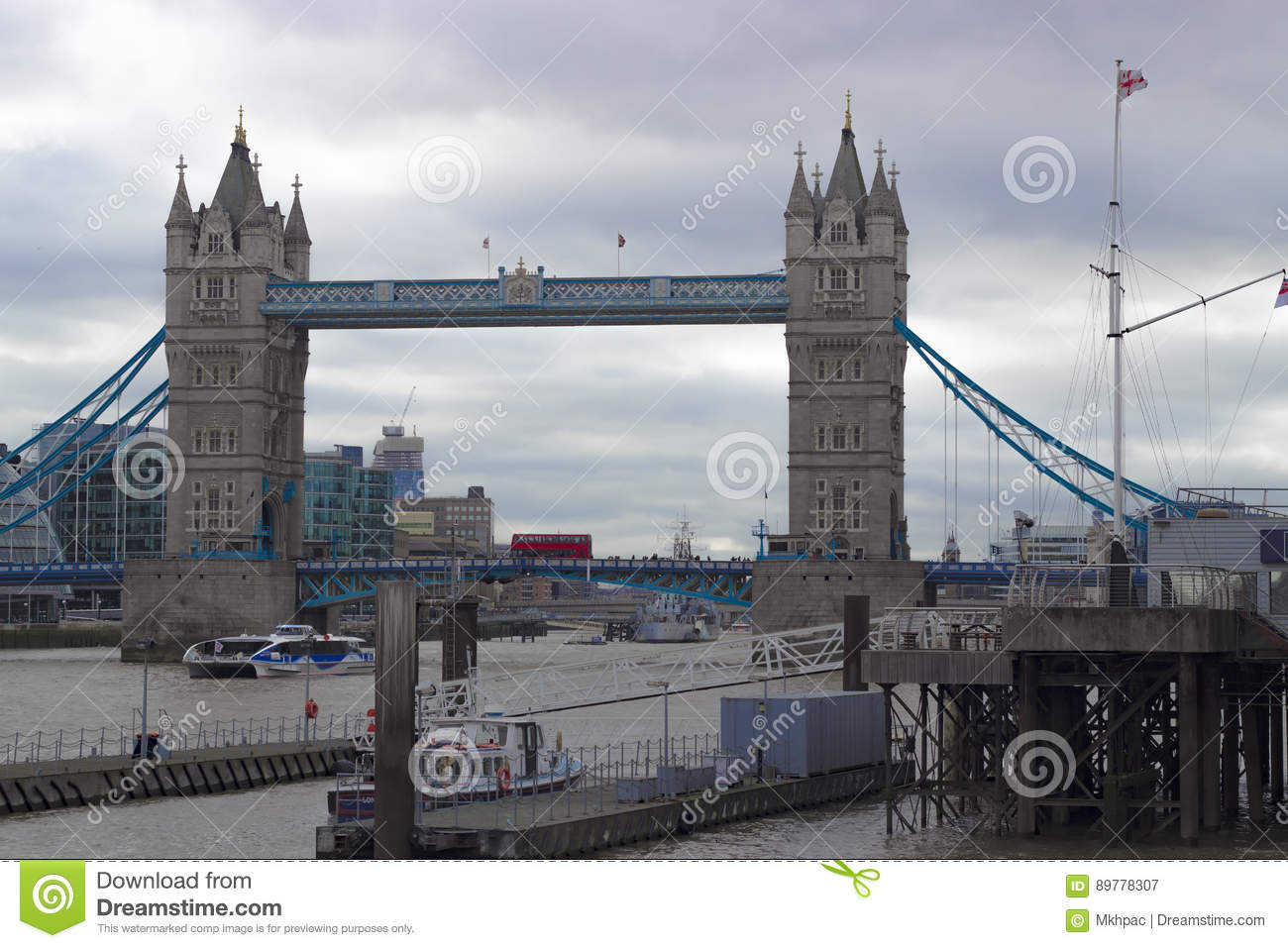 Red British Bus Driving Over The Famous And Iconic Tower Bridge Of London Above Thames River In England United Kingdom