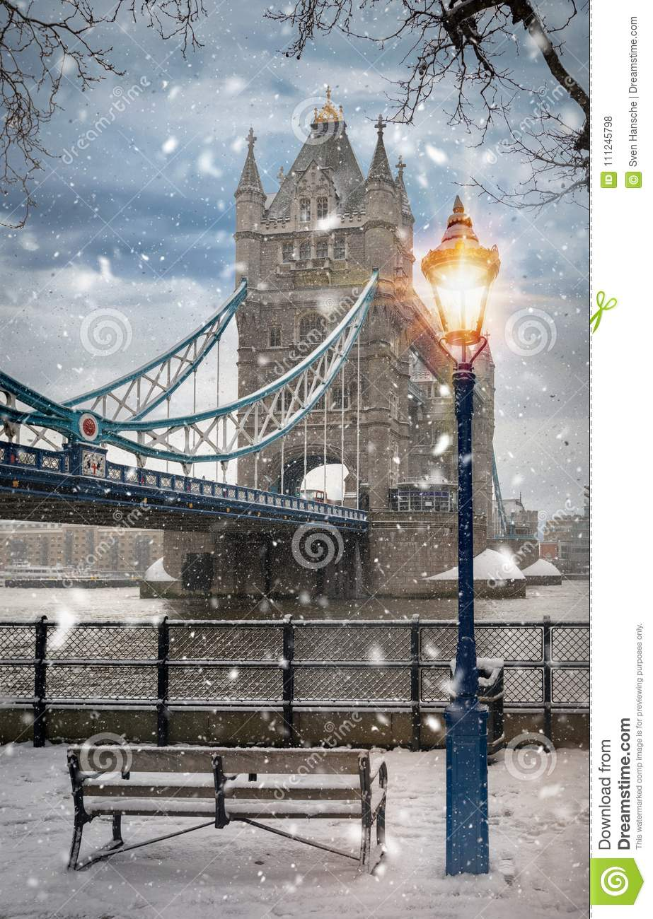 The iconic Tower Bridge of London on a snowy afternoon