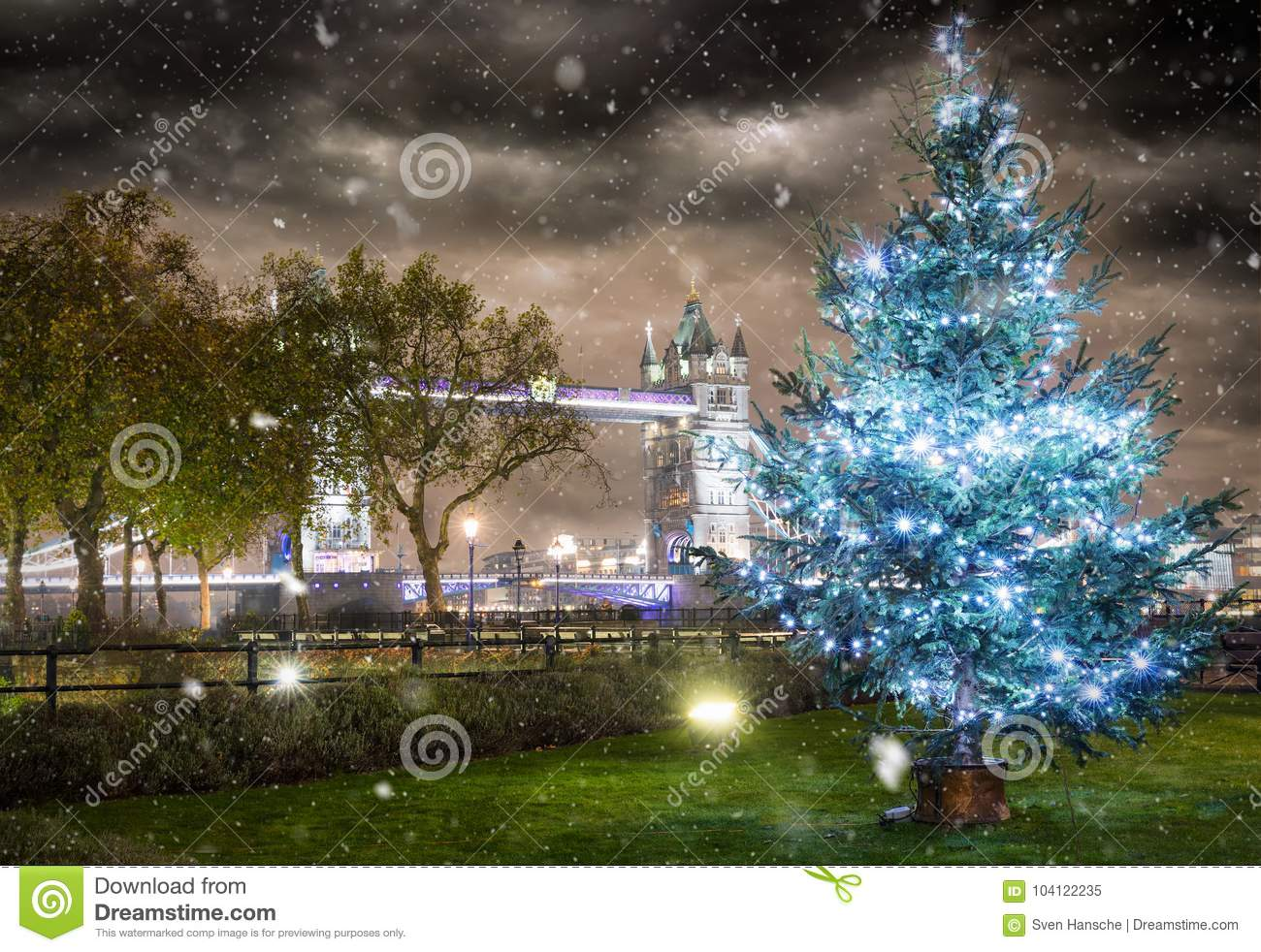 The iconic Tower Bridge in winter time with a christmas tree