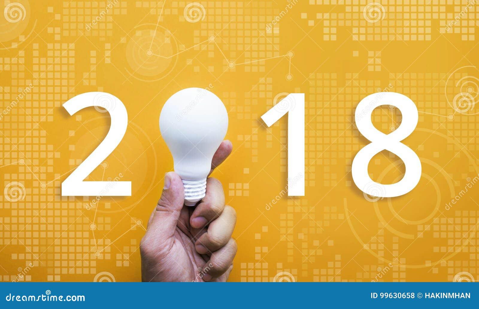 2018 Ideas creativity concept with human hand holding light bulb