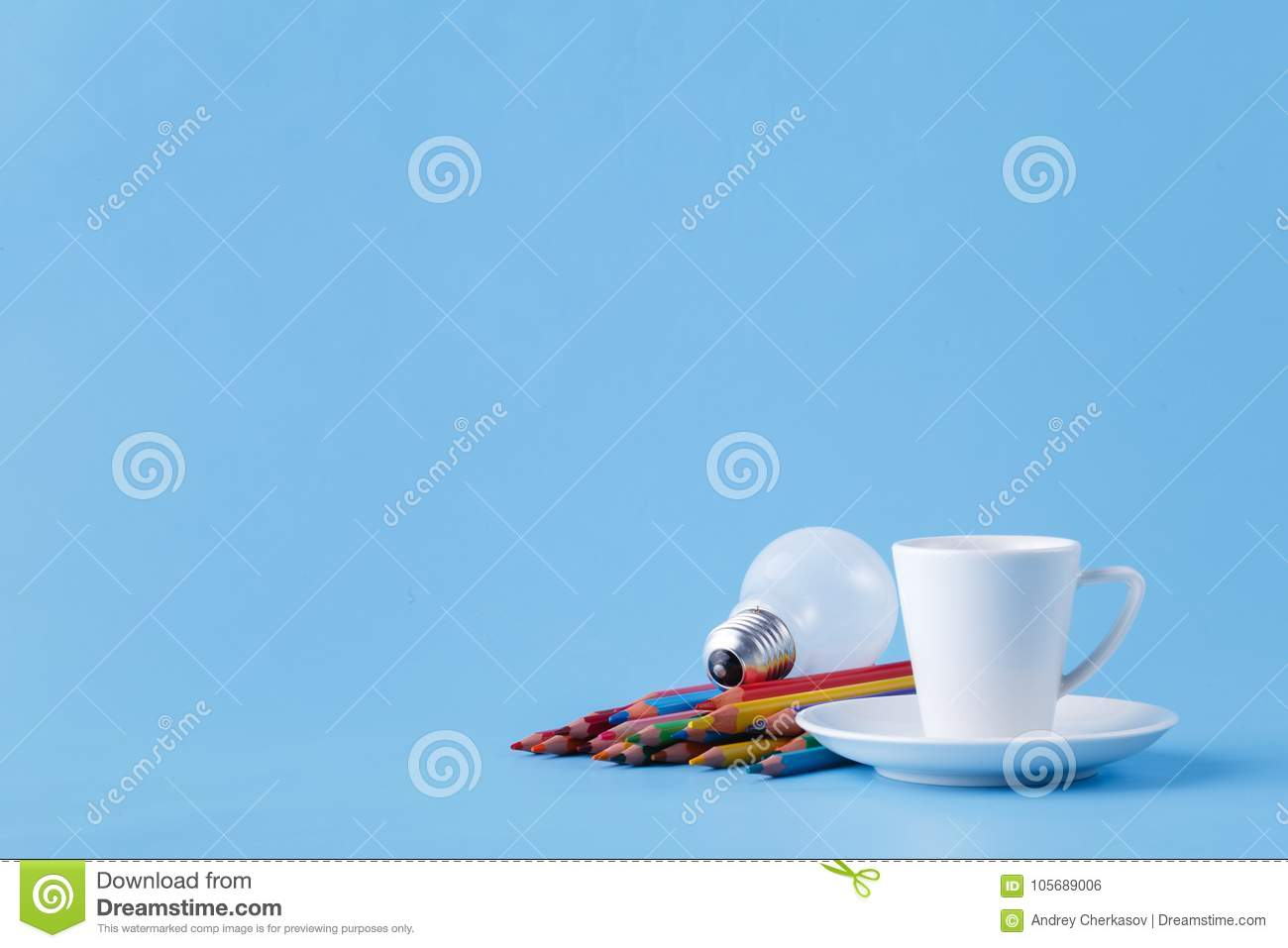 Ideas and energy for artist, coffee, light bulb and colour pencils
