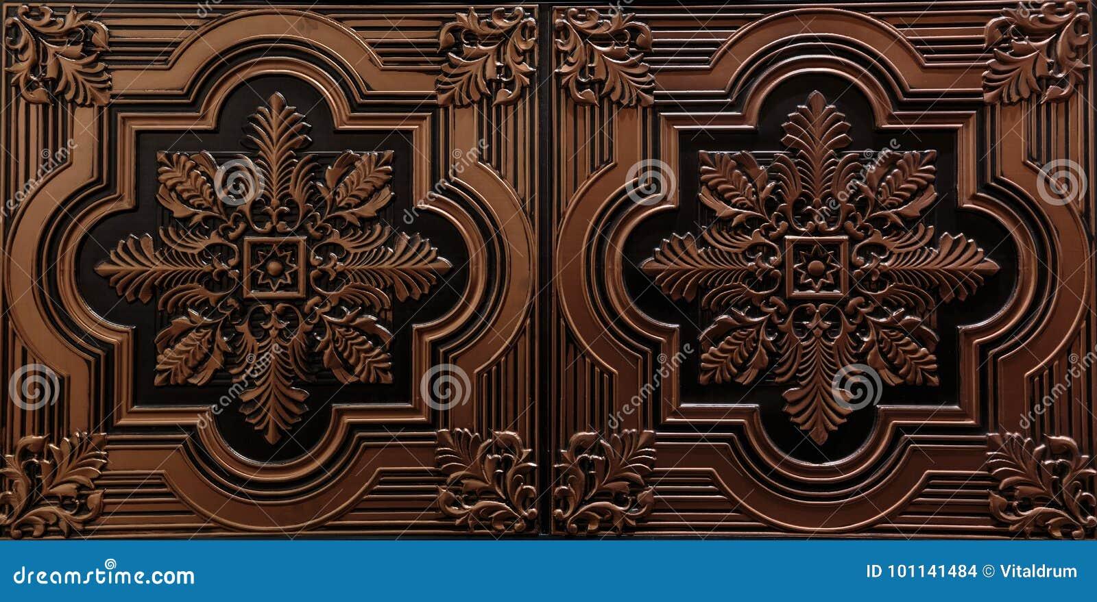 A ideia luxuosa surpreendente do close up lindo do teto textured do marrom detalhado, escuro telha o fundo