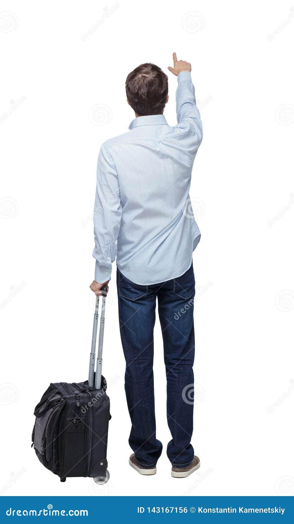 Ideia traseira de apontar o homem de negócio com mala de viagem