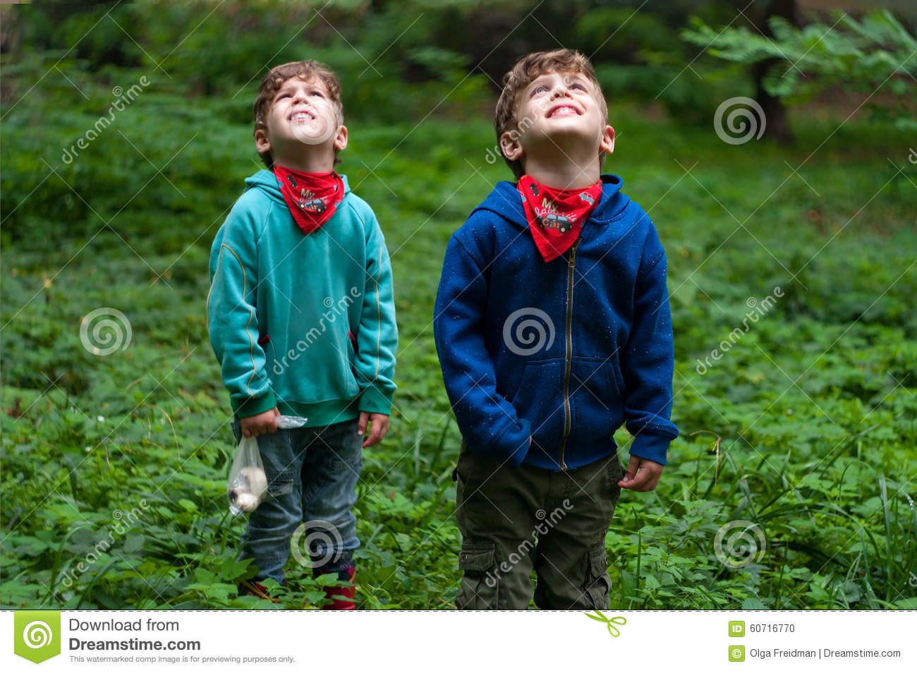 Identical twin brothers look to the sky