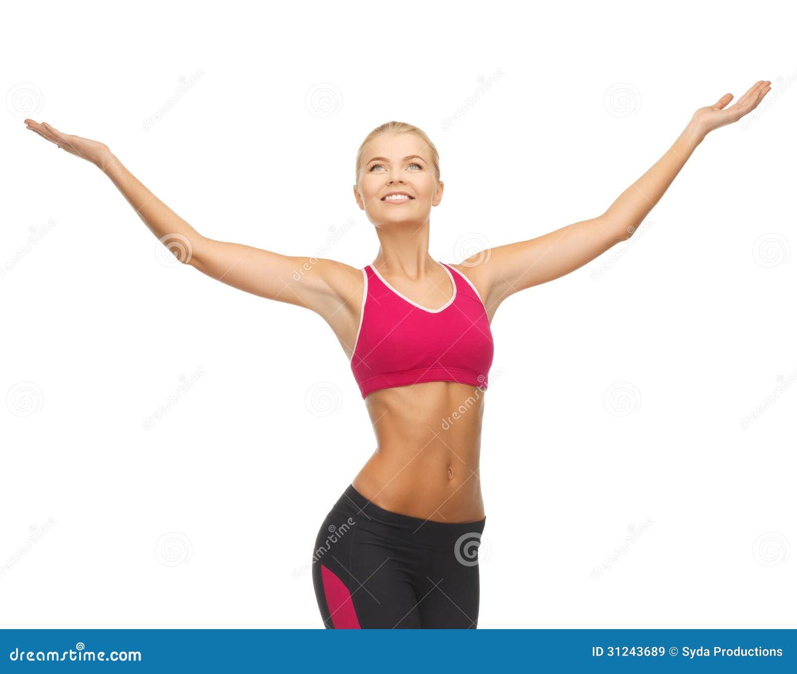Idrottskvinna med lyftta upp händer