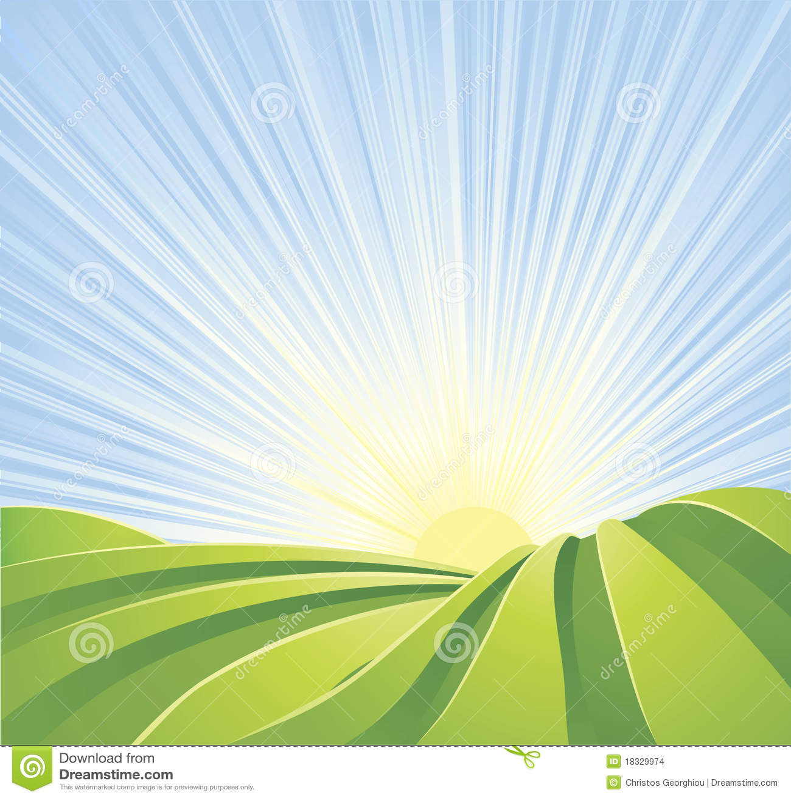 Idyllic green fields with sun rays blue sky