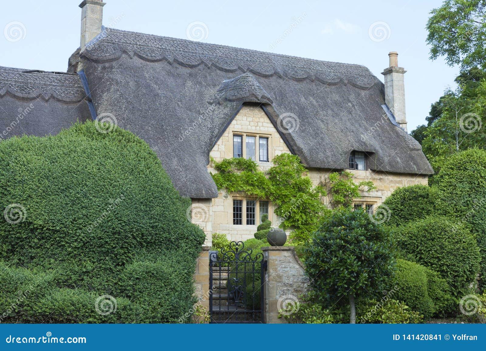 Idyllic Old English House With Topiary Tree Garden Stock Image