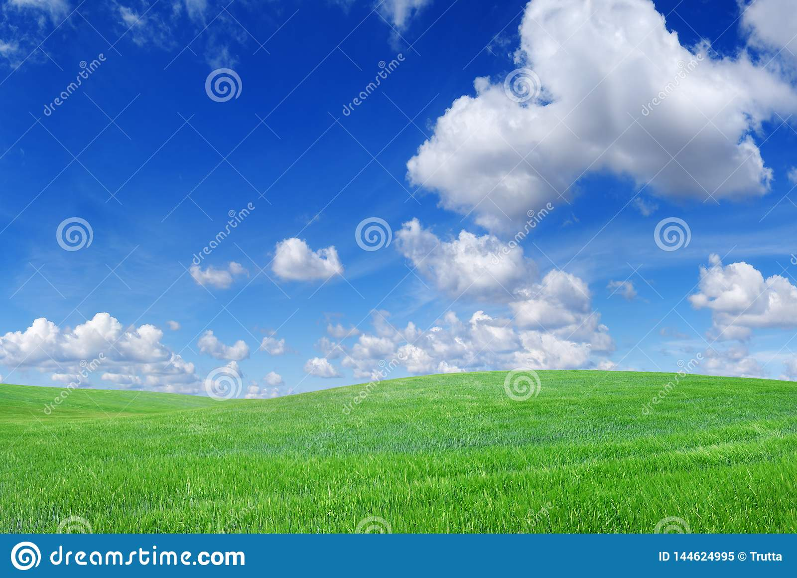 Idyllic view, green hills and blue sky