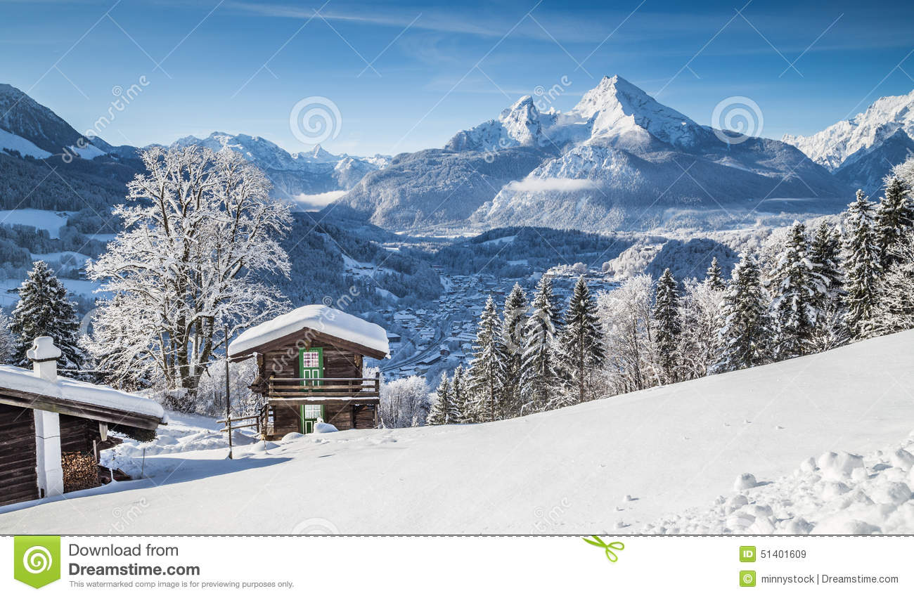 Idyllic winter landscape in the Alps with mountain lodge