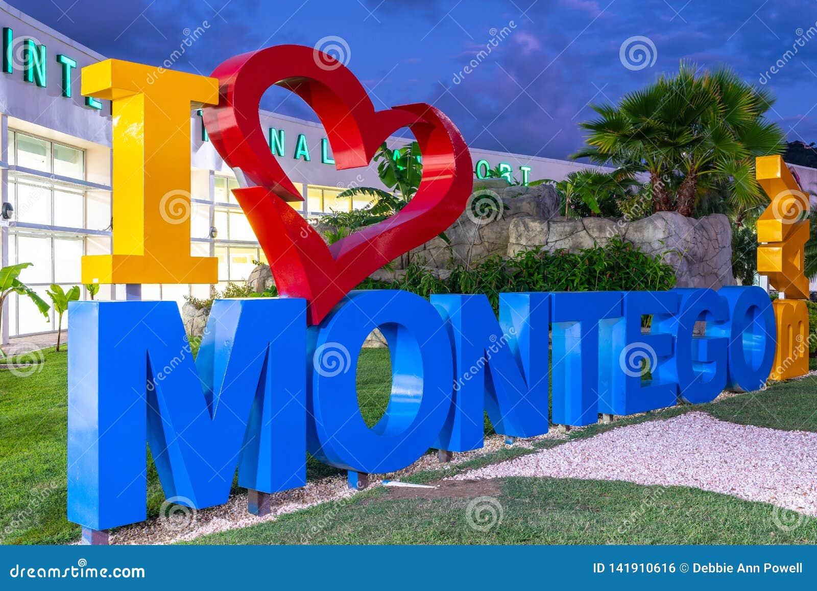 Ik houd Montego-van Baai I het teken van hartmontego bay bij de Internationale Luchthaven van Sangster