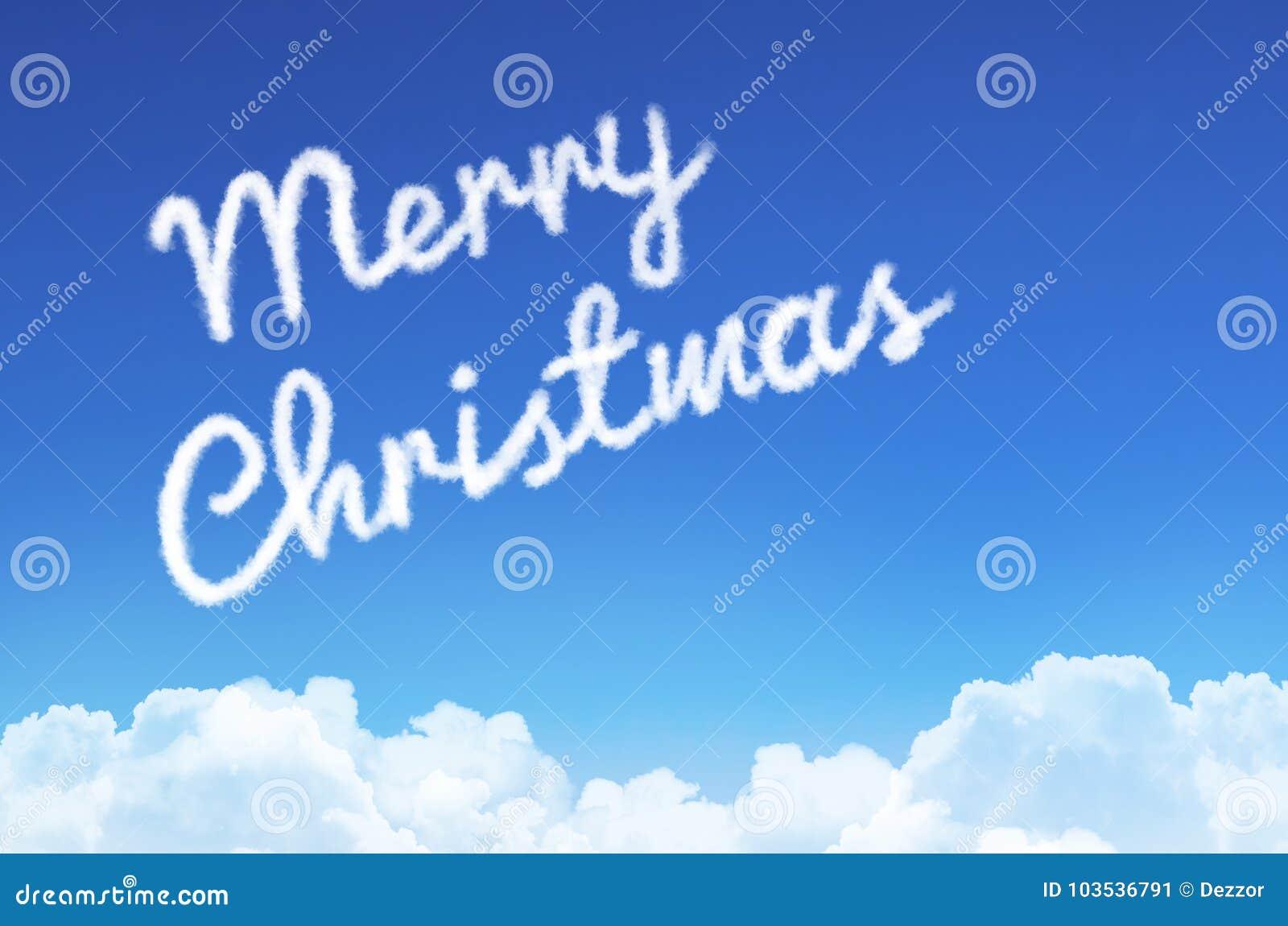 Il Buon Natale dell iscrizione nel cielo dalla nuvola e dal vapore