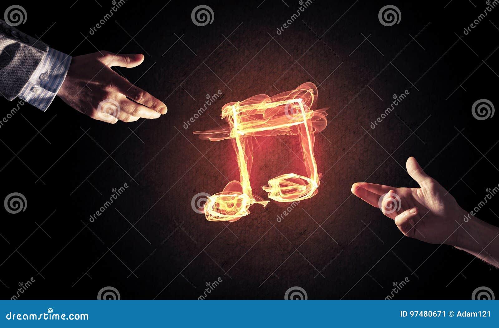 Il concetto di musica ha presentato dall icona bruciante del fuoco e dal gestur della creazione