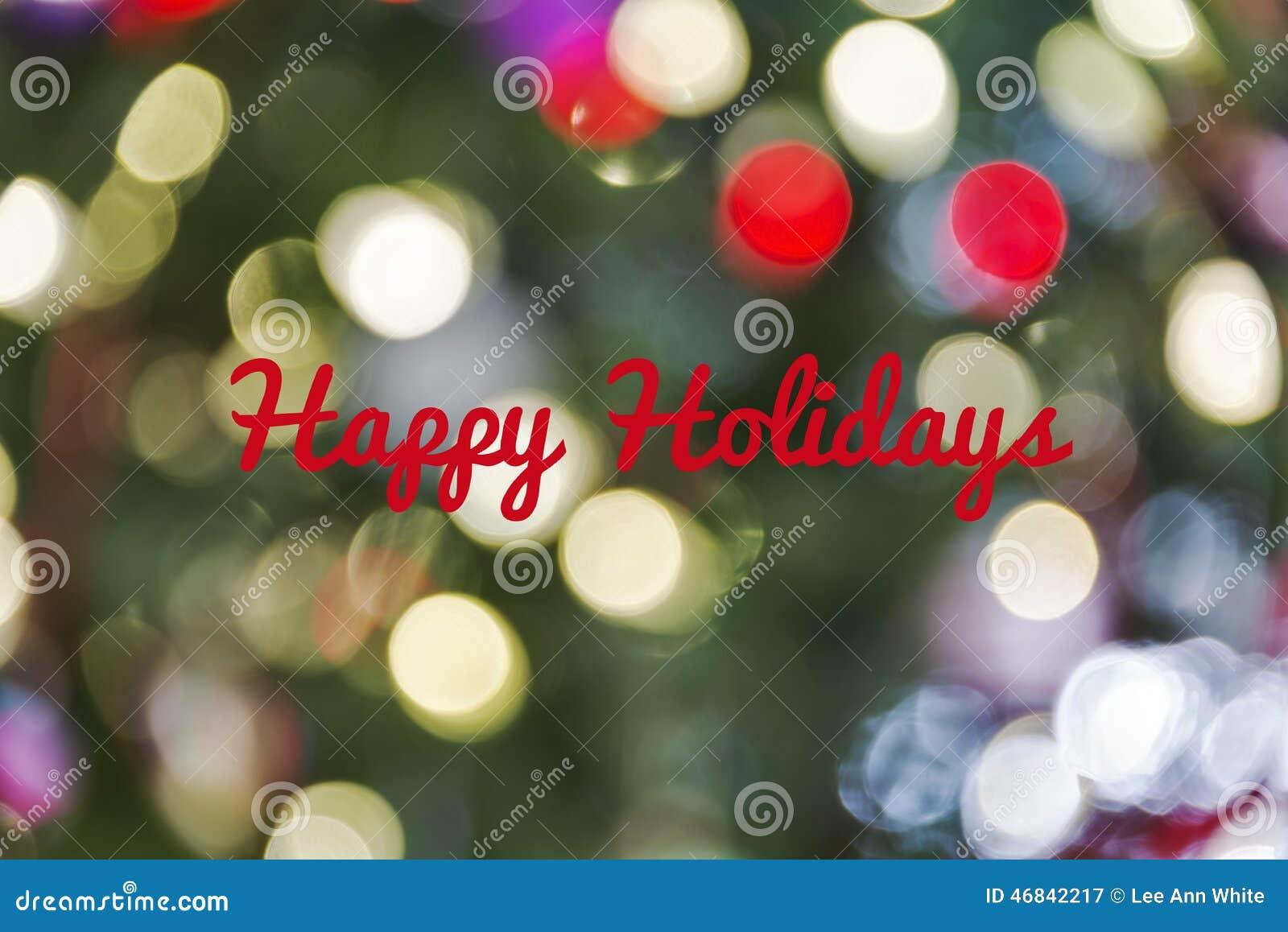 Il fondo Defocused della luce di Natale con le feste felici manda un sms a