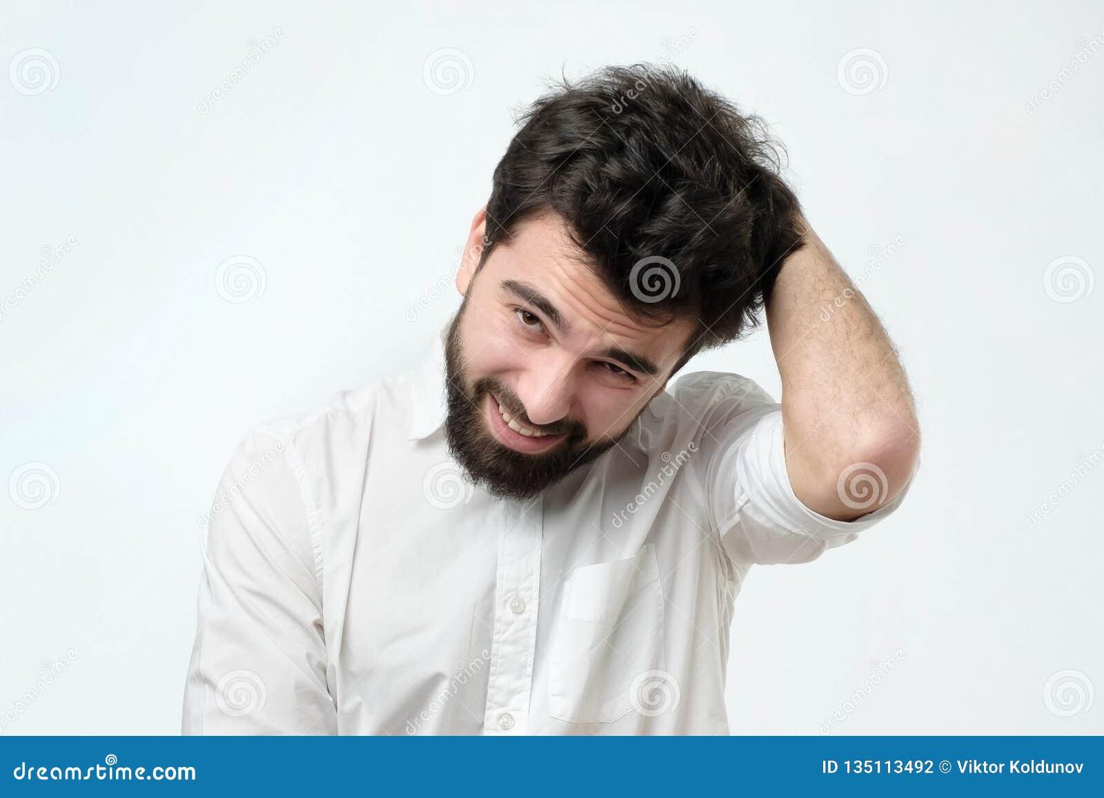 Il giovane uomo d affari adulto ha un dubbio Colpo dello studio