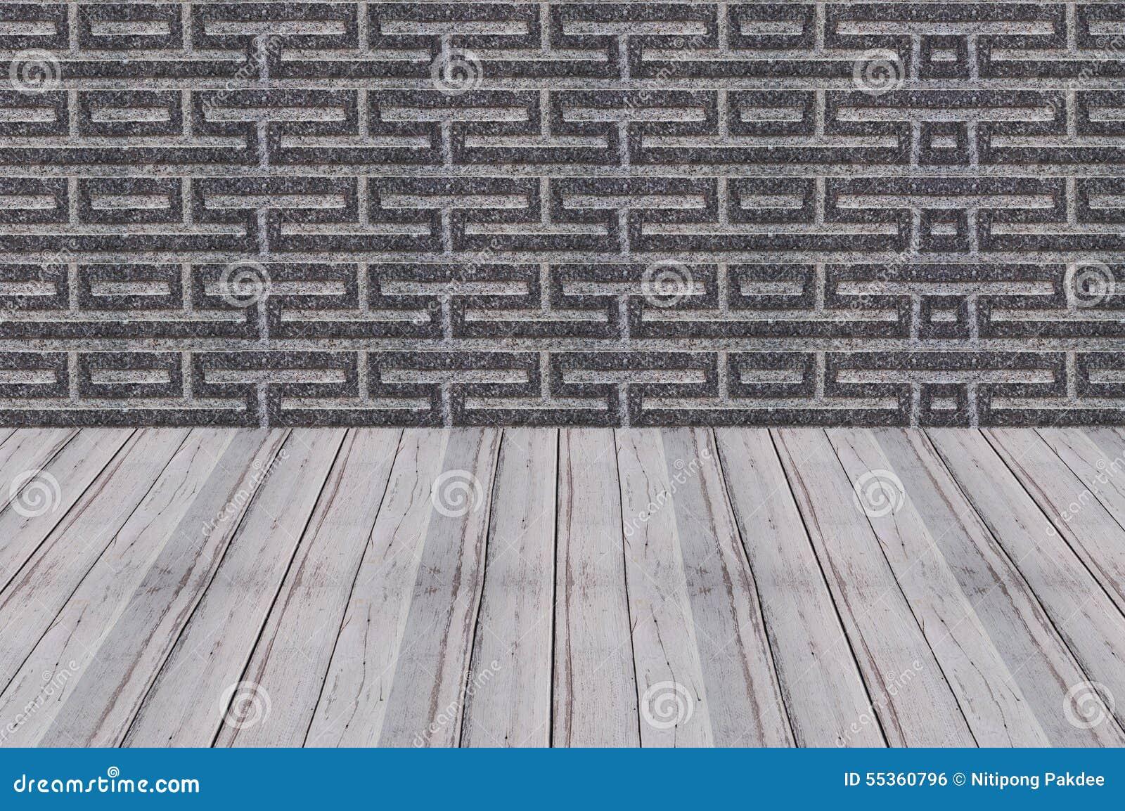 Il legno pavimenta il fondo della parete del cemento di prospettiva