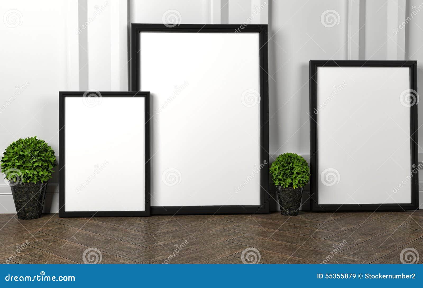 Il modello dello spazio in bianco tre incornicia il manifesto sul pavimento