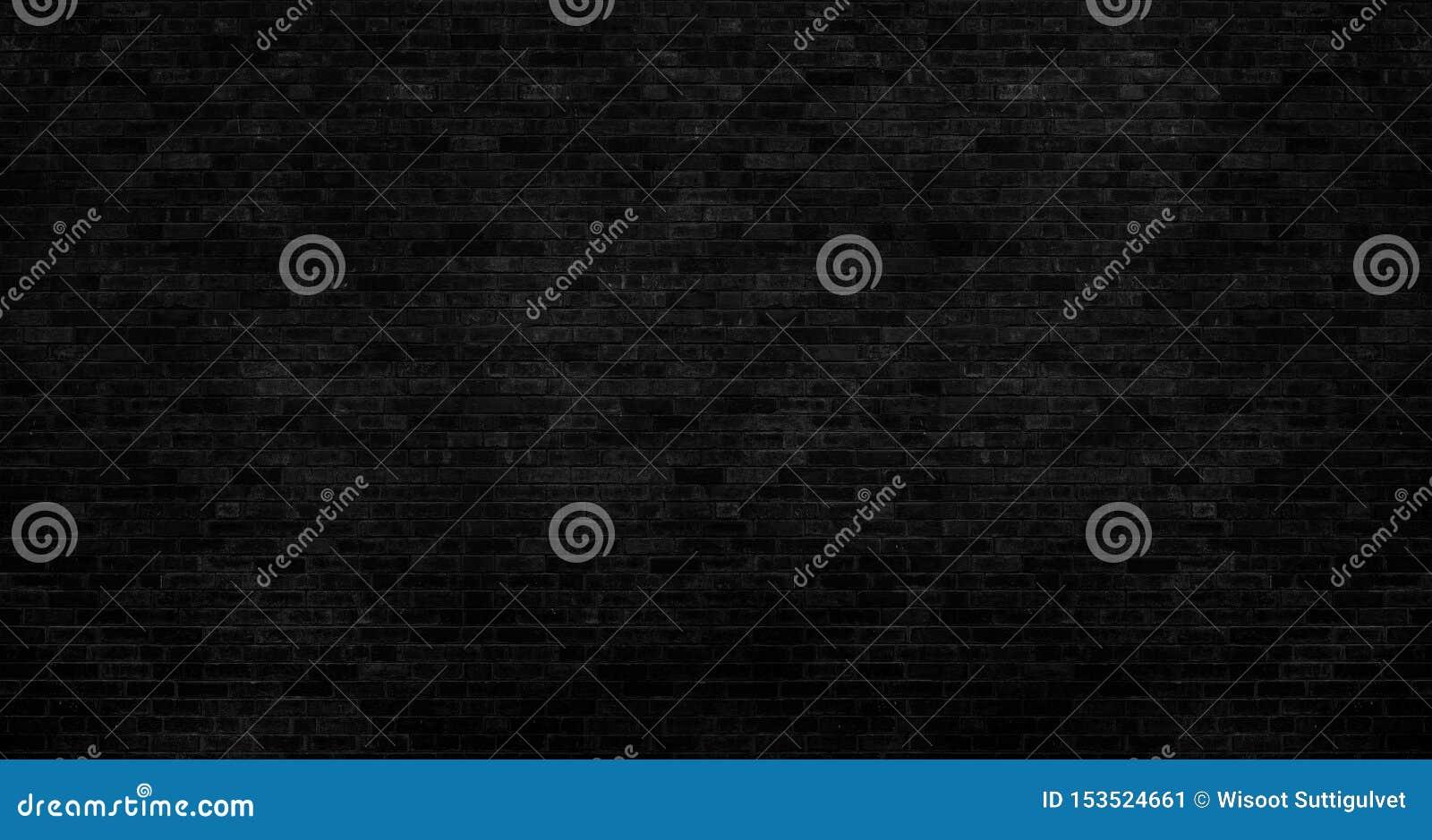 Il muro di mattoni nero scuro ha una superficie ruvida come immagine di sfondo