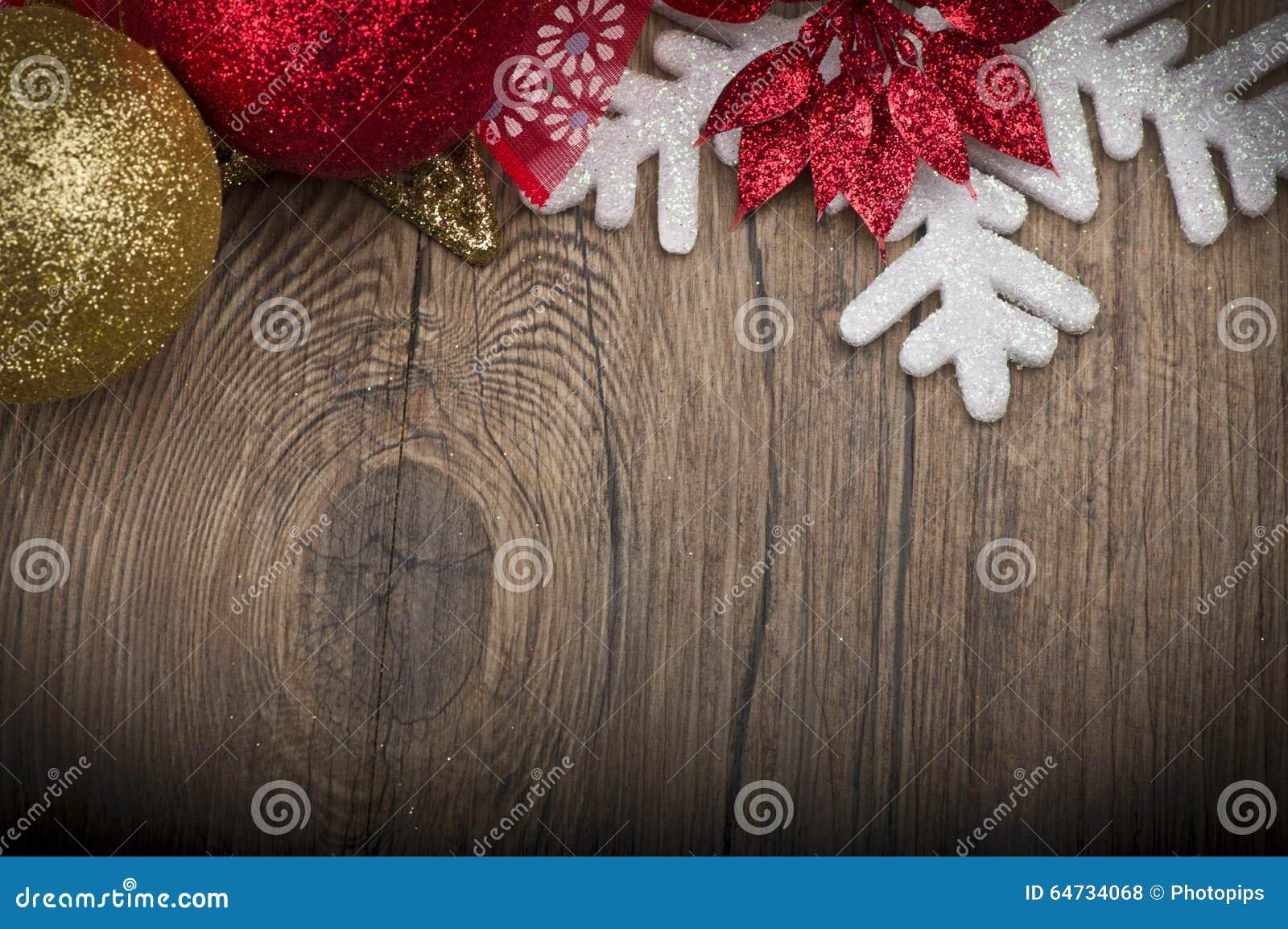 Il Natale incornicia sulla tavola di legno