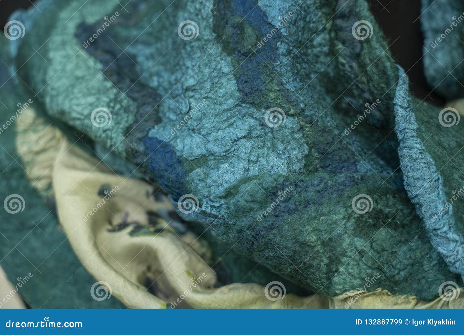 Il tessuto ha ritenuto per merlettare decorativo verde, progettazione,