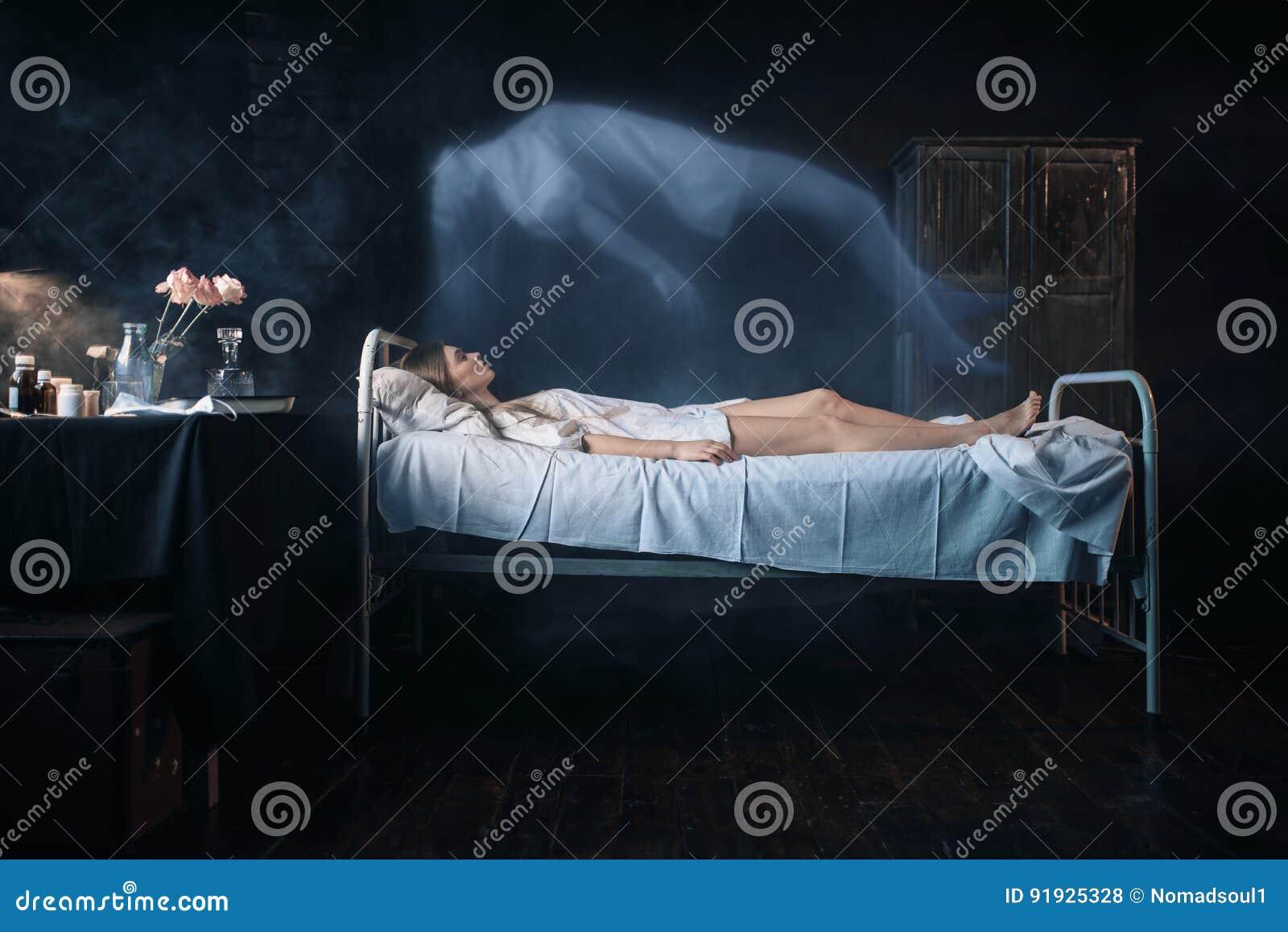 Ill woman lying in hospital bed, soul leaves body
