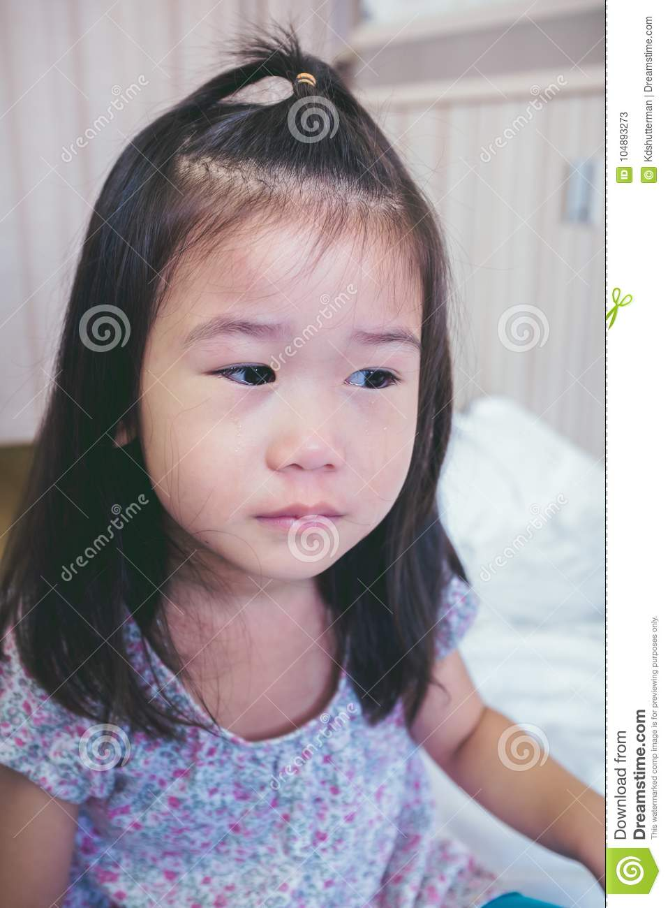 Illness asian child crying while admitted in hospital. Vintage t