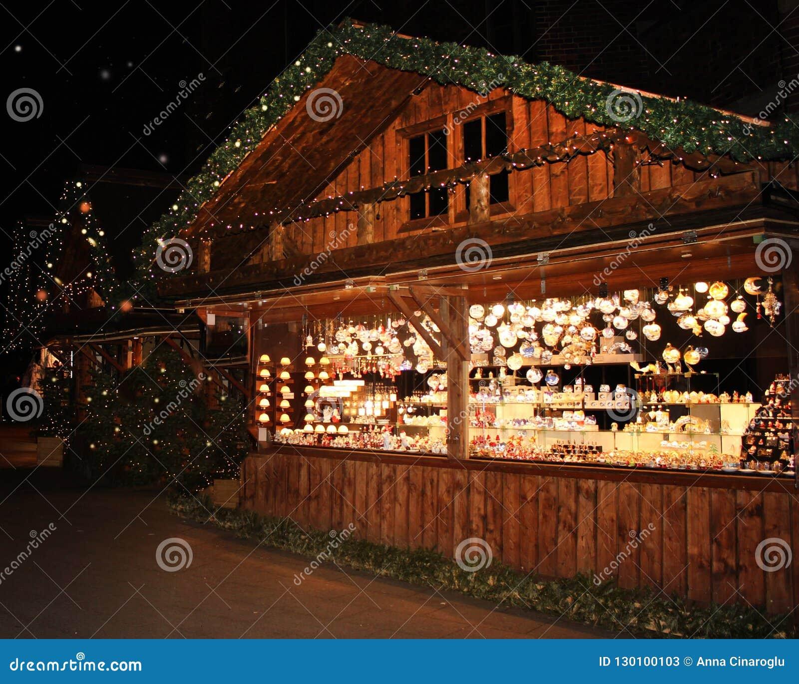 Mulled Wine Christmas Market.Illuminated Christmas Market Fair Kiosk Sale Of Mulled Wine