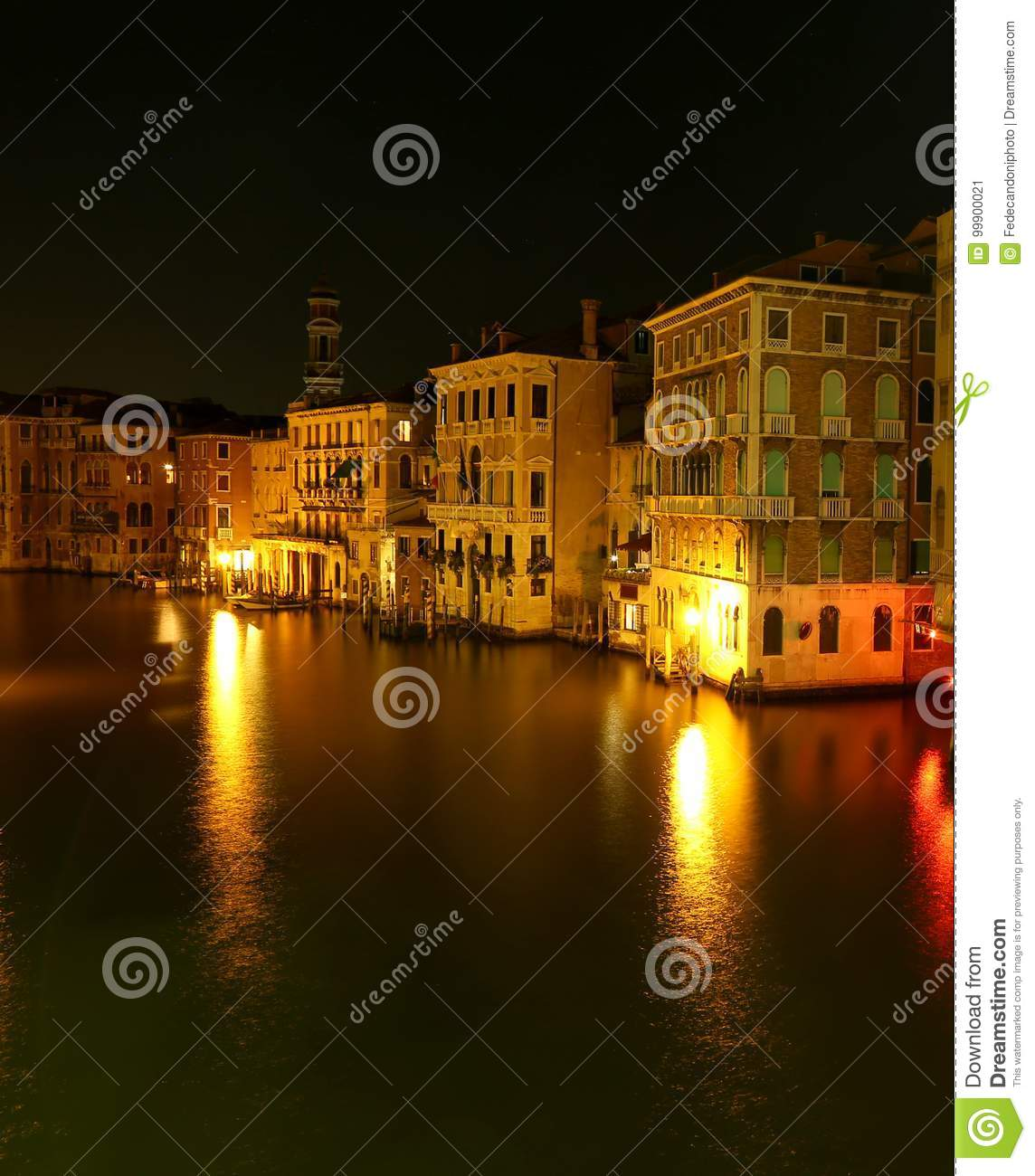 illuminated houses with reflection on the Grand canal of VENICE