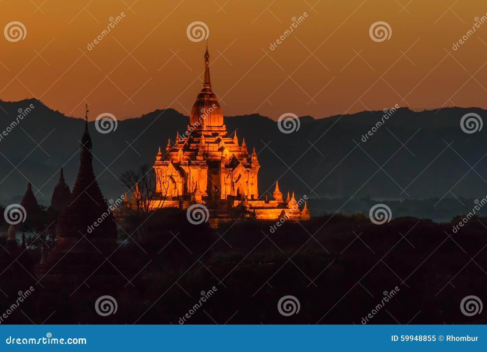 The illuminated Htilominlo temple at sunset