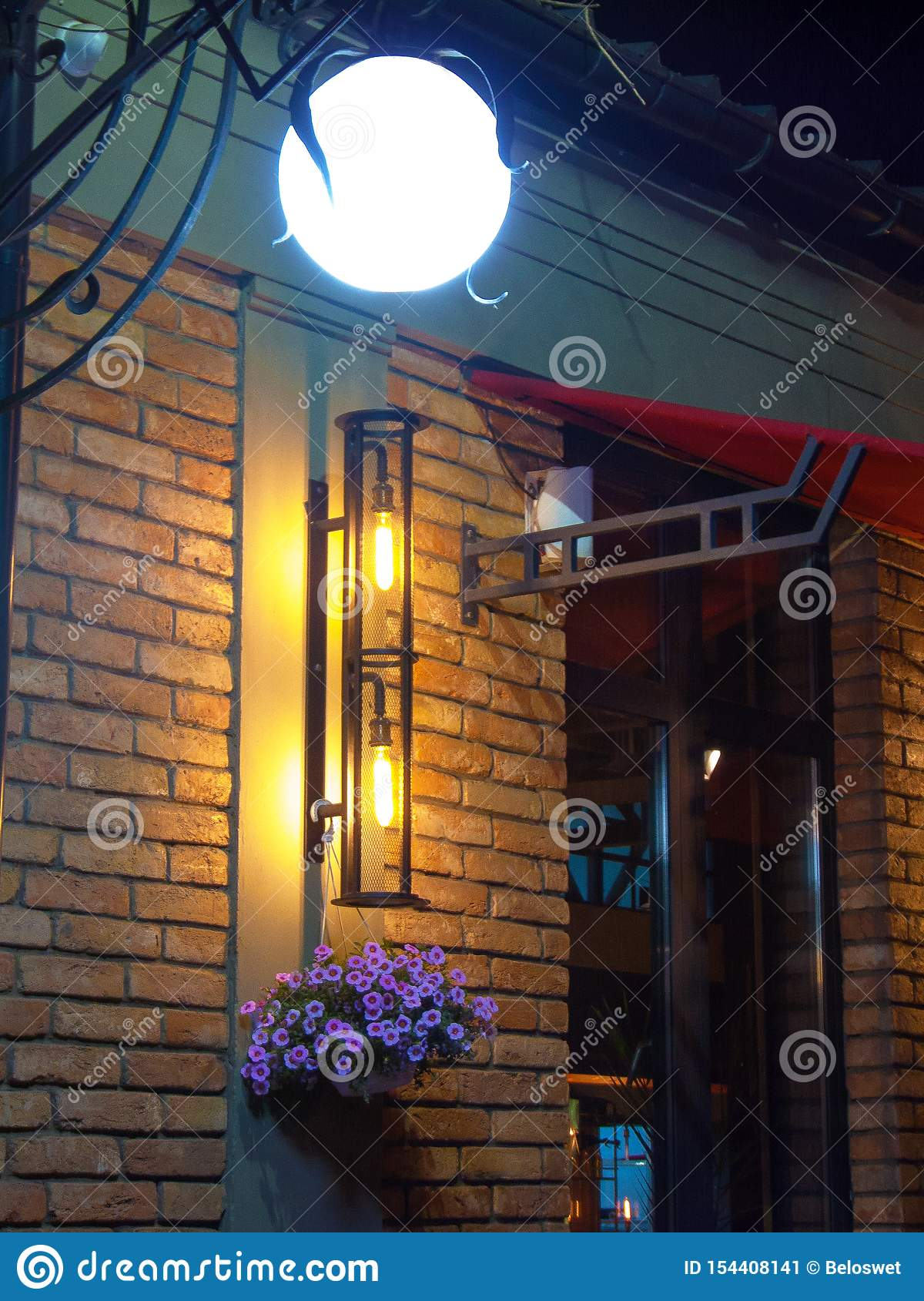 Illuminated lamp `moon` brick wall flowers Forget-me-not night lights, decorative design of a recreation area