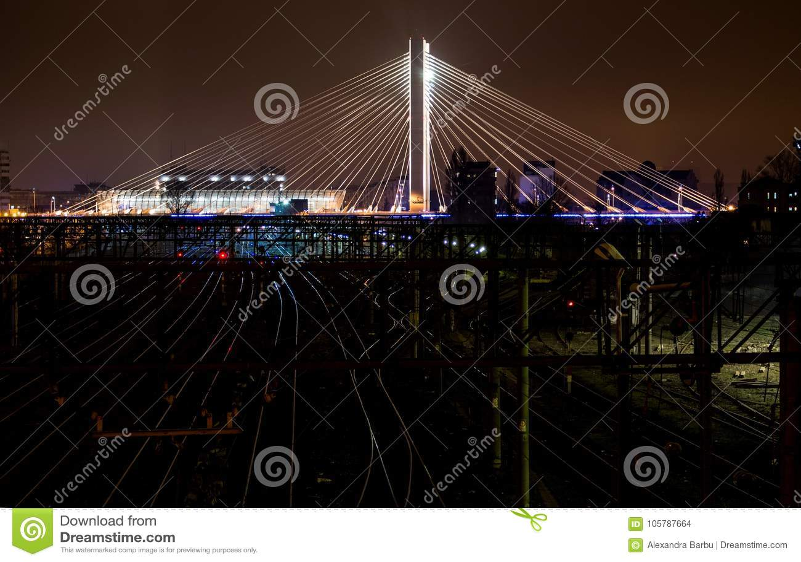 Illuminated Suspended bridge over railway urban modern landmark city night scene