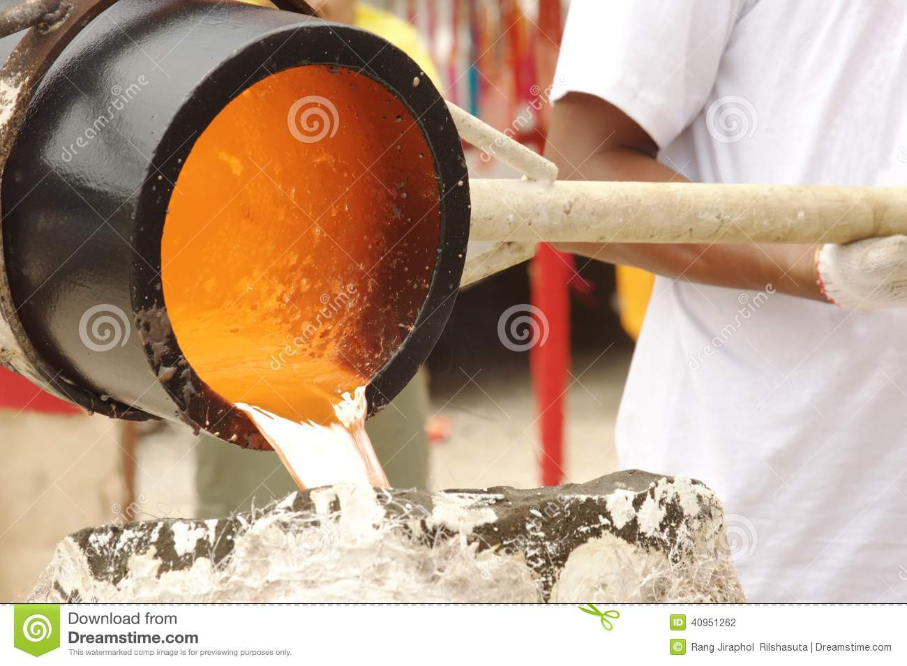 Illustration of molten metal being poured from a foundry crucible statue