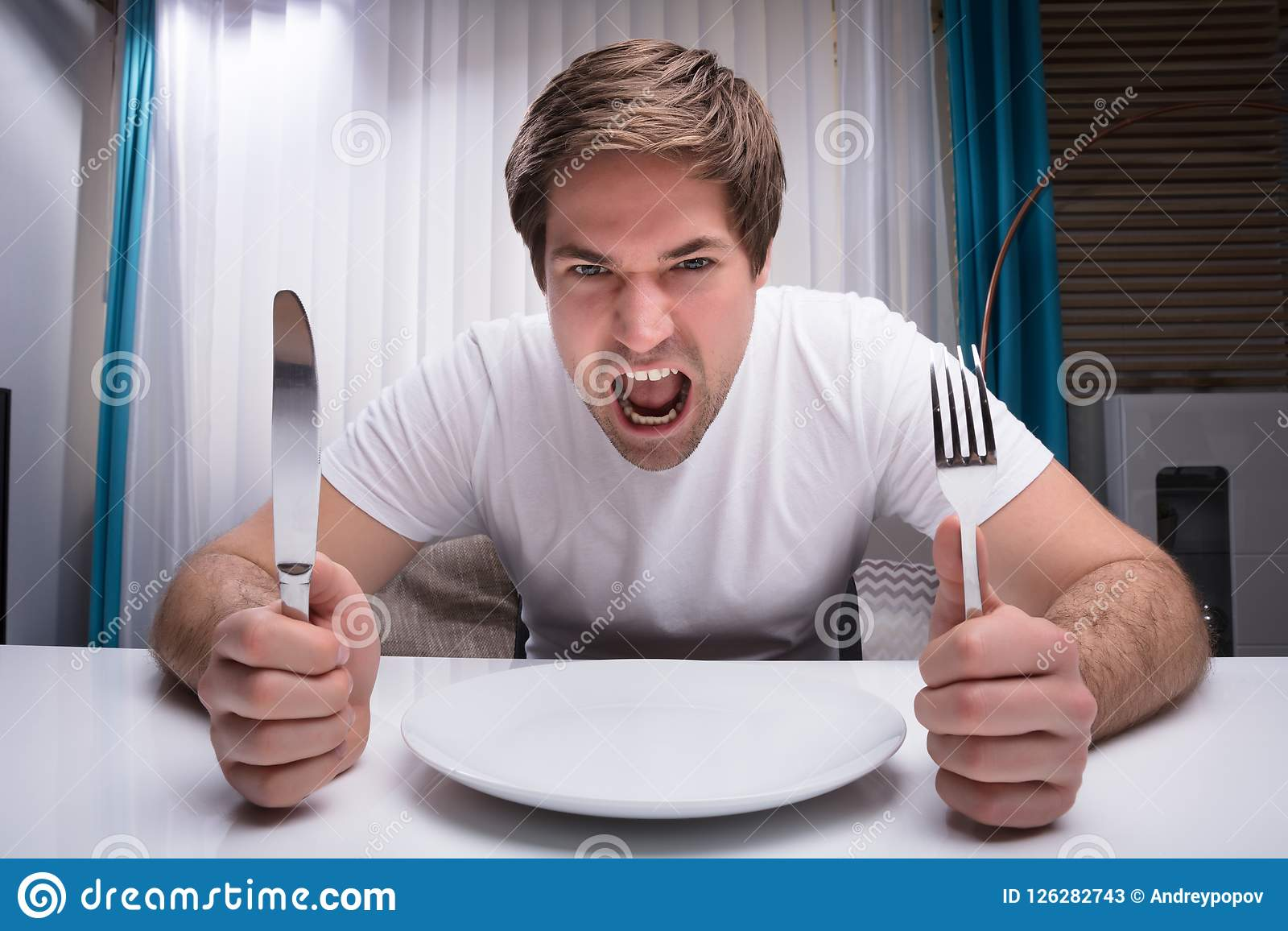 Ilsken maninnehavkniv och gaffel