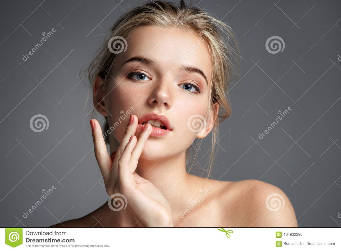 Image with beautiful blonde girl touching her lips