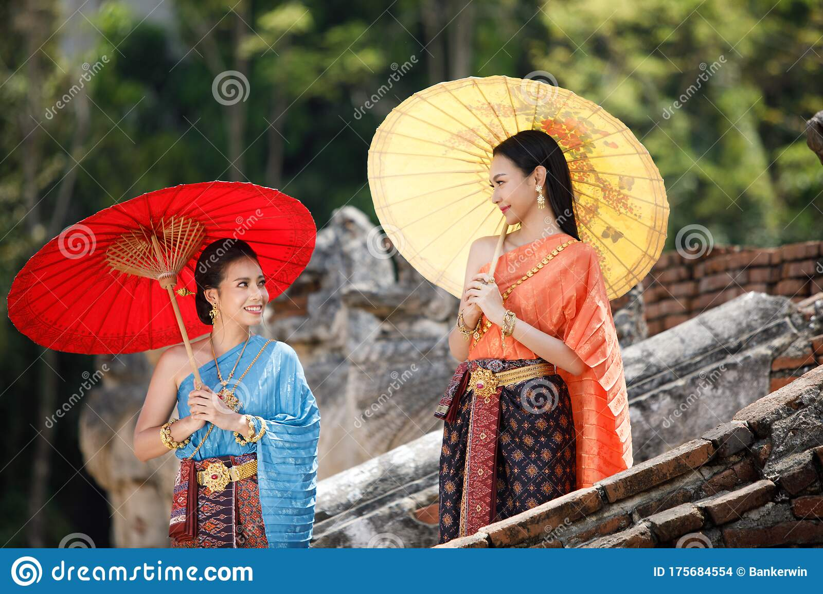 Asian Woman Wearing Traditional Thai Culture At Temple