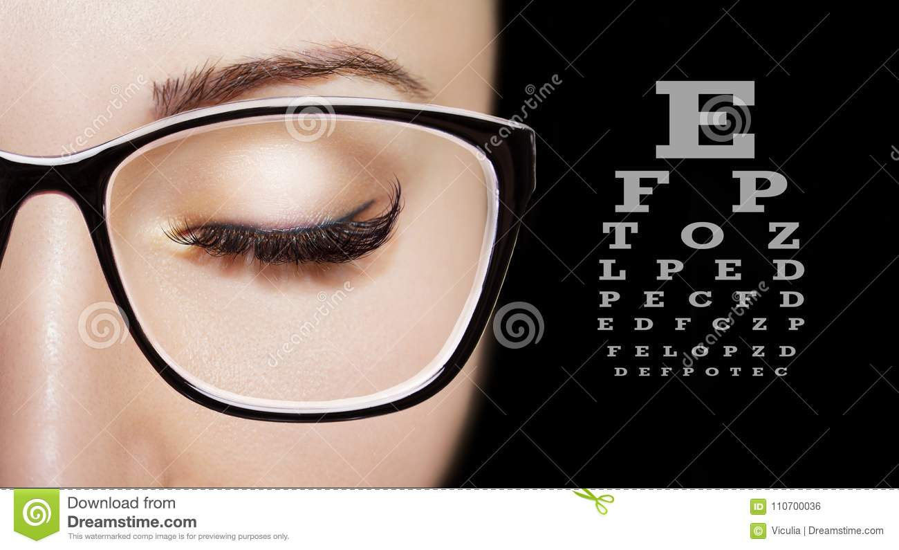 Image of a beautiful young girl wearing glasses. Close up