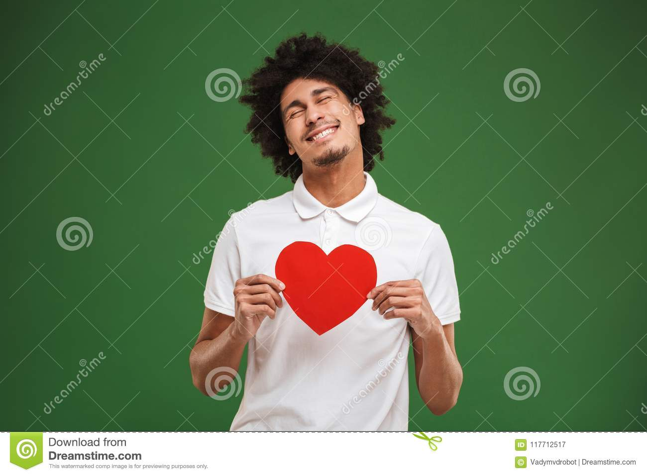 Download Cheerful Young African Curly Man Holding Heart. Stock Image - Image of portrait, confident: 117712517