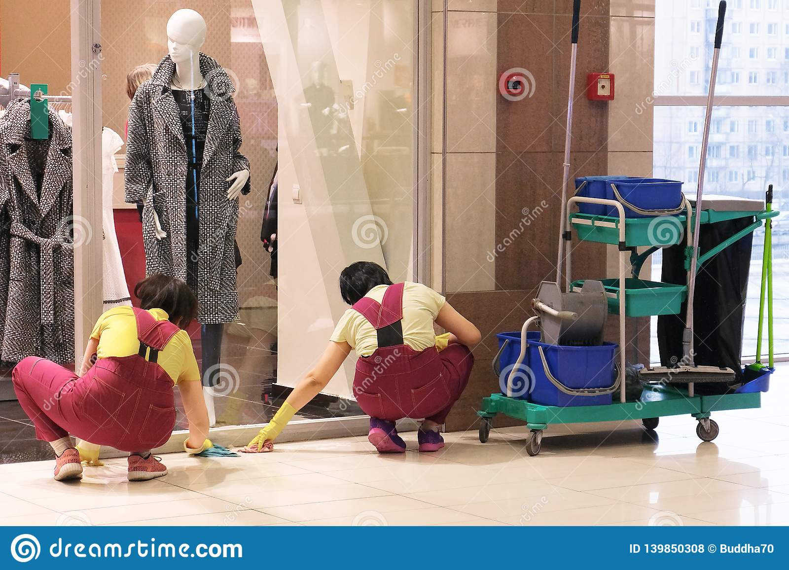 Image Of The Cleaners At The Mall Two Women Wipe Stains On The Floor Tools Nearby Stock Photo Image Of Department Hospital 139850308