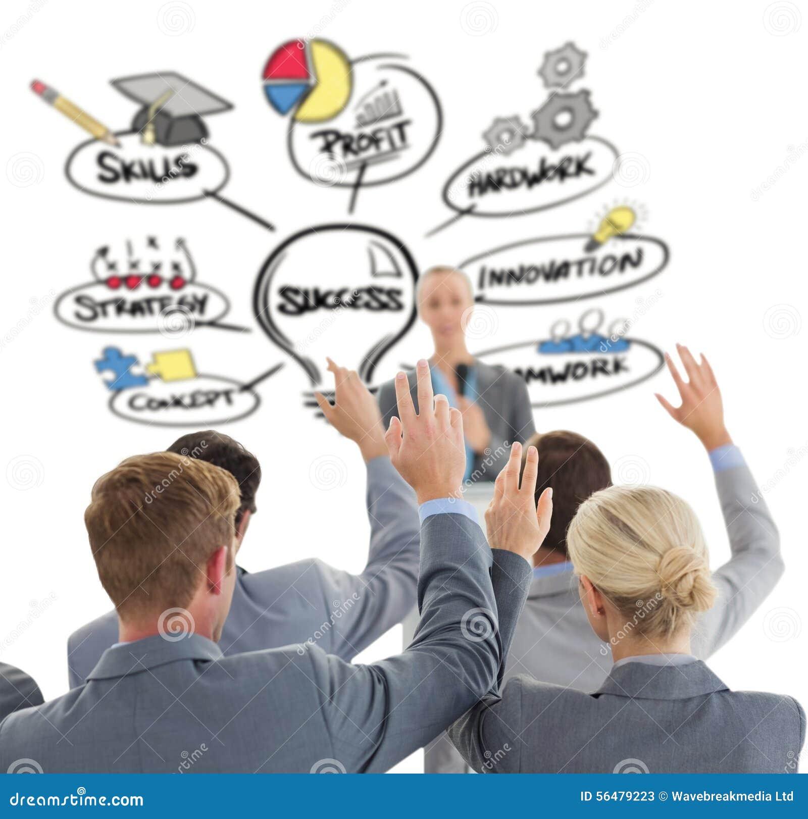 Image composée d équipe d affaires soulevant des mains pendant la conférence