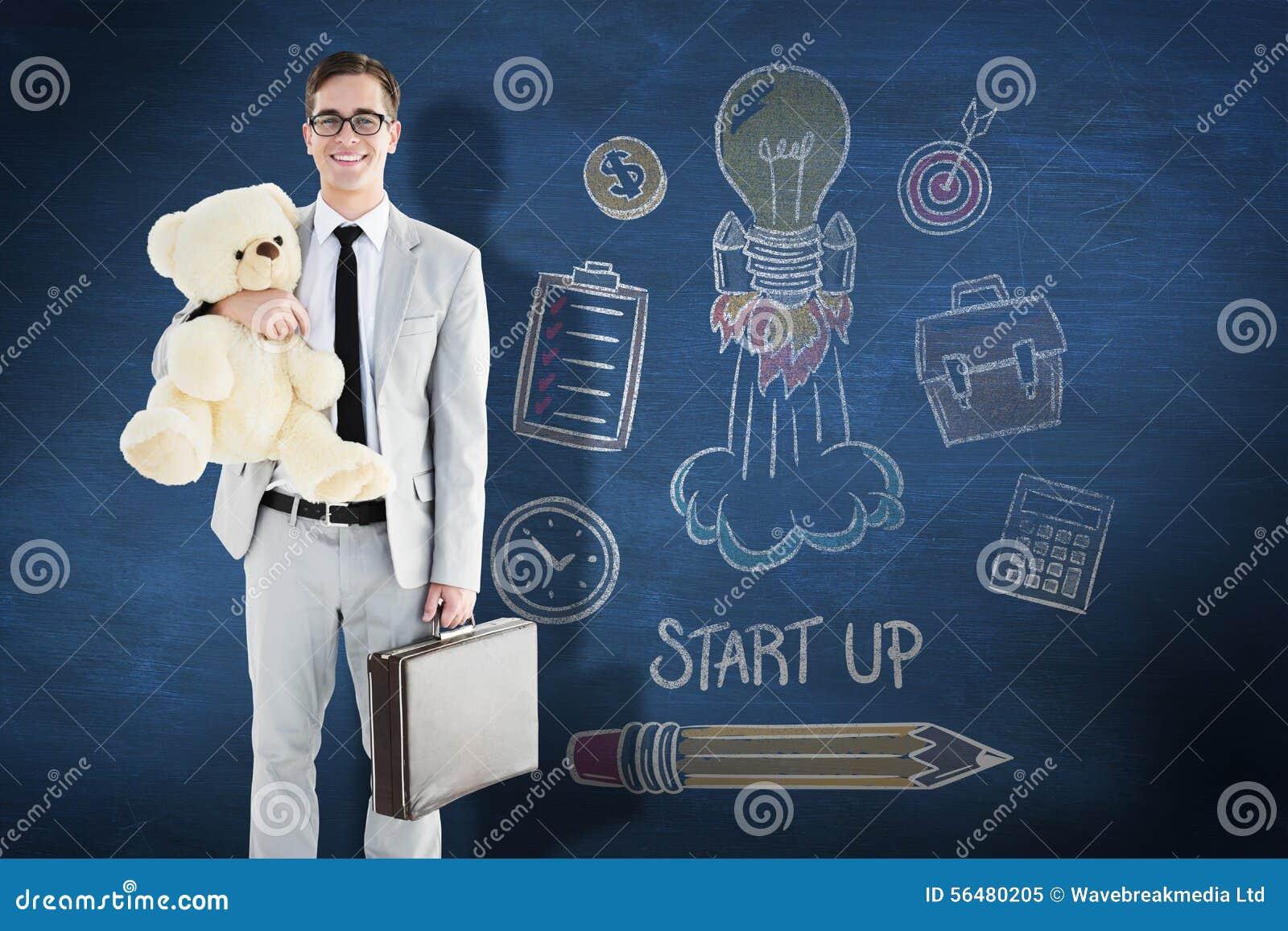 Image composée d homme d affaires bel tenant la serviette et le nounours