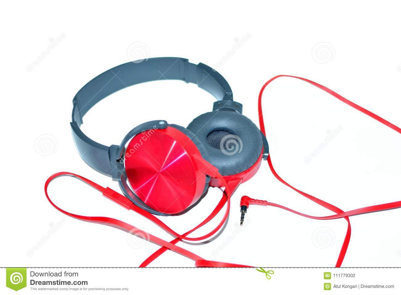 Red shiny wired headphones isolated