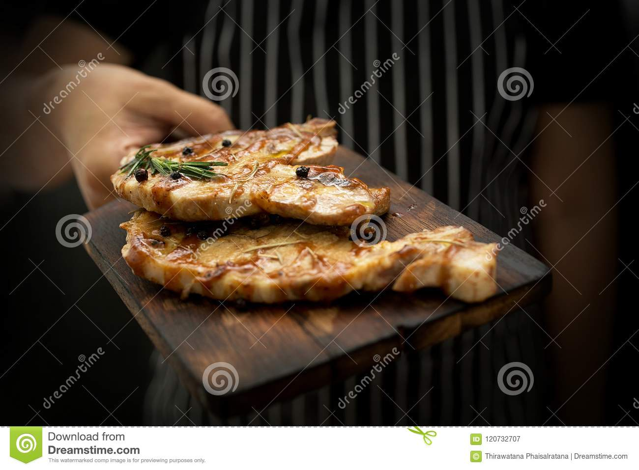 Image cooking on kitchen. Master Chef holding steak. Woman Chef