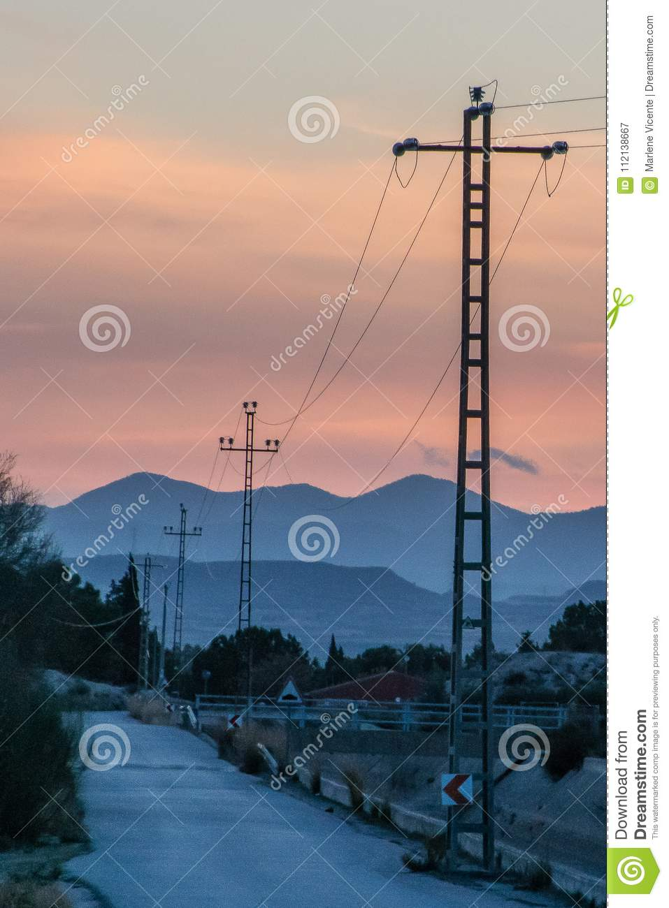 Image of electricity towers at sunset