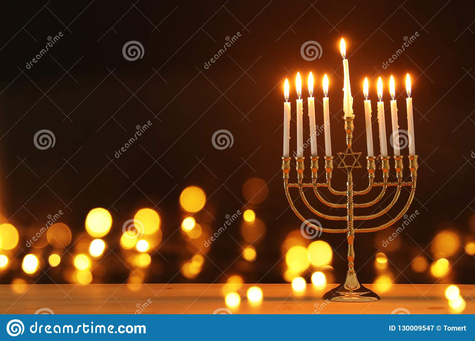 image of jewish holiday Hanukkah background with menorah & x28;traditional candelabra& x29; and candles.