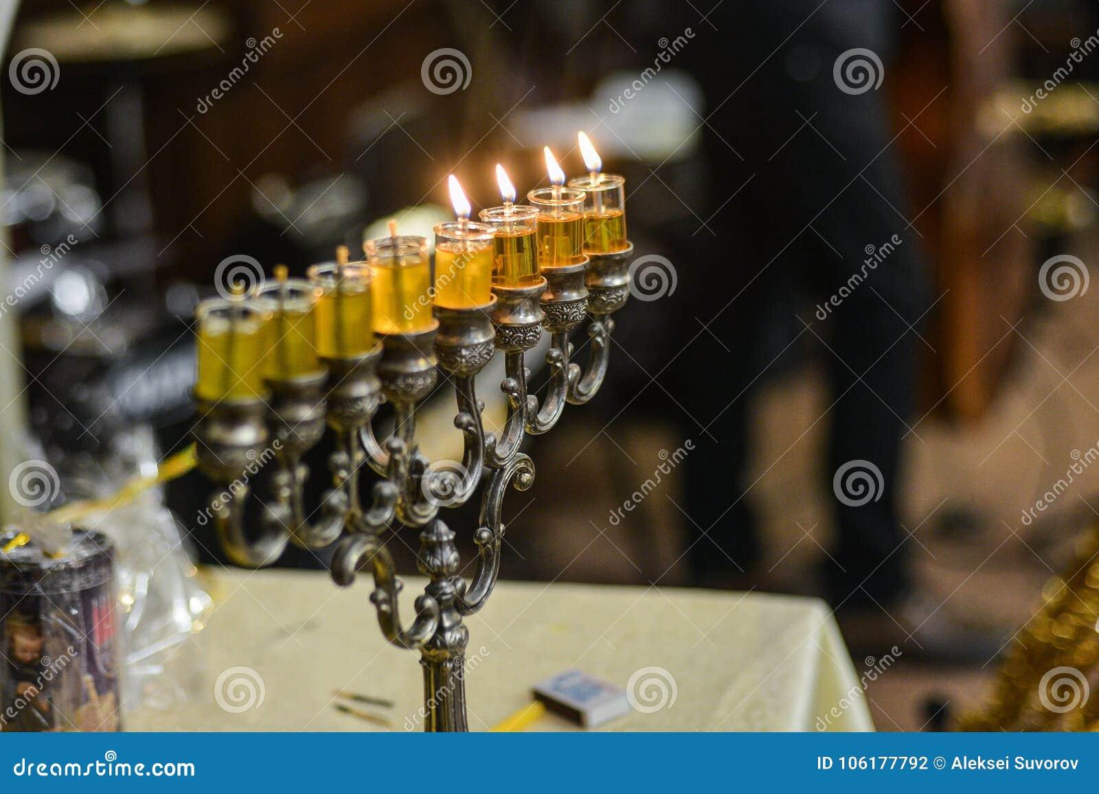 Image of jewish holiday Hanukkah background with menorah traditional candelabra