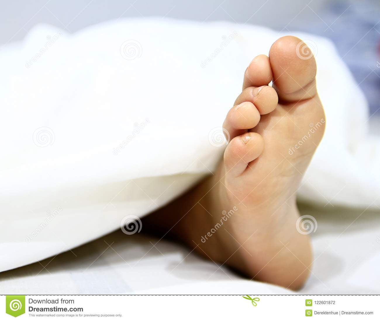 Image Of Little Boys Feet In Bed